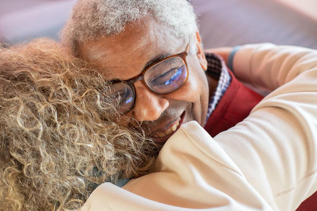 Happy older couple hugging
